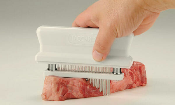 Using Jaccard Meat Tenderizer on a piece of meat