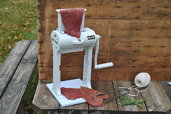 Weston Meat Tenderizer on wood table with meat